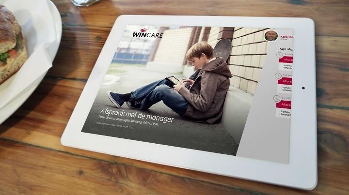Werken met WinCare bij de cliënt aan tafel